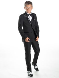 A navy slim fit boys suit portraying a highly modern look and ...