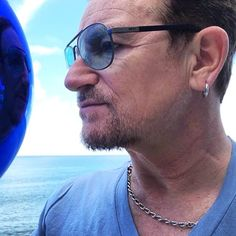 Bono and the shades of blue...
