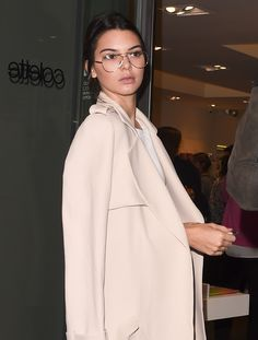 Model-of-the-moment Kendall Jenner stepped out during Paris Fashion Week in a pair of attention-grabbing eyeglasses. Ironically, it's what wasn't there that photographers and bloggers are clamoring for.