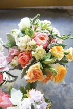 Pretty bouquet of peach + pink roses, sweet pea and veronica