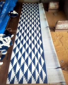 Blue and white geometric design laid out on a floor loom that is the traditional technique for making flat weave rugs in India.  #handloom #art #artisan #talent #interiordesigner #home #homedecor #floor #rug #popofcolor #theatticdubai #dubai #uae #singapore #hongkong #australia #worldwide #shipping