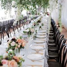 traditional wedding reception table with pink and white flowers and black chairs.hanging greenery installation, long tables with floral centerpieces in peach, cream, white and burgundy. Wedding Reception Chairs, Wedding Table Settings, Wedding Seating, Wedding Ceremony, Princess Wedding Dresses, Modest Wedding Dresses, Pewter Wedding, Flower Decorations, Wedding Decorations