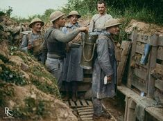 The arrival of hot soup at a Portuguese trench, Neuve-Chapelle sector, 25th July, 1917. As one of the soldier (wearing an informal vest) digs around the liquid looking for something edible, others wait patiently. The transport of warm food to the front was not a daily affair, and it also not without risk: Snipers targeted these men knowing that the lack of a hot meal was detrimental to soldier's moral. Artillery barrages and other dangers were ever present during the journey to the front…