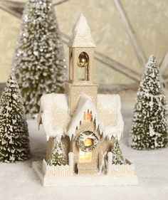 Bethany Lowe Designs. Pressed paper, bottle brush trees covered in textured snow and glitter. 12 1/2 x 7 x 5 3/4. Can light up with optional C7 Light sold separ