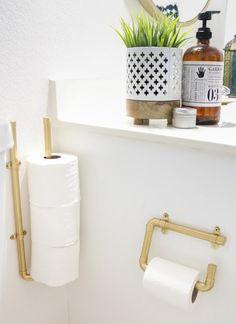 By gilding toilet paper holders constructed from hardware store pipes, A Kailo Chic Life gave this bathroom a glam look, but with an industrial edge.