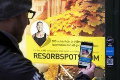 Download web app through QR code on billboard.