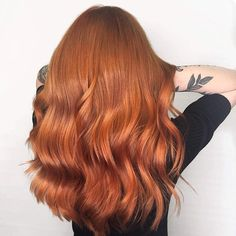 Copper red hair looks striking in long lengths. Wella color created by Ida Westerberg.