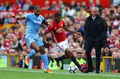 Glen Johnson of Stoke City and Marcus Rashford of Manchester United battle for possession during the Premier League match between Manchester United...