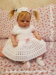 Vestitino con fascia per capelli e scarpine lavorati all'uncinetto per bambola reborn adatto anche alle bimbe.   Dress with hair band and crochet shoes for reborn doll also suitable for girls.  #vestitino #vestito #fasciacapelli #scarpine #scarpe #uncinetto #crocheted #crochet #handmade #fattoamano #diy #bebè #bebe #bimba #baby #reborn #doll #dolls