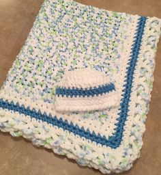 Super Soft white/blue/green baby blanket with crisscross edging and matching hat up to 6 month $58