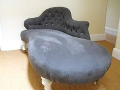 Antique deep buttoned curved end chaise longue in charcoal grey linen with silver military buttons.