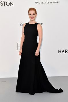 Jessica Chastain Evening Dress - Jessica Chastain went for simple elegance in a sleeveless black Prada gown at the amfAR Gala Cannes 2017.