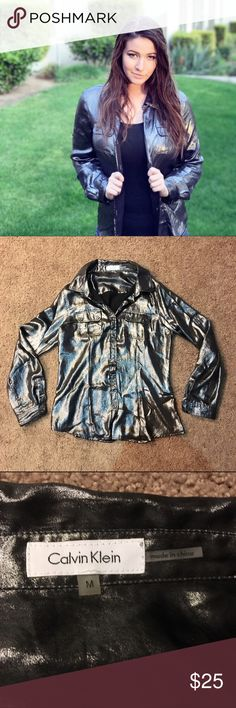 〰Calvin Klein Blouse〰 Loving this rockin top! Calvin Klein shimmery button up blouse. Great for your next concert attire! True to size! Only been worn once! Calvin Klein Tops Button Down Shirts