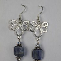 Lovely kyanite square beads dangle from sterling silver plated vintage inspired connectors. Bali silver spacers and Chinese crystal surround the kyanite. Sterling silver head pin and silver plated surgical steel ear wire. 2 1/2 inches from top of ear wire to bottom of earring. Comes wrapped in ti...