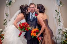 Father of the Bride, kissed by his girls.