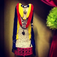 Fashionable heart jeweled scarfs available in red, yellow, and blue.