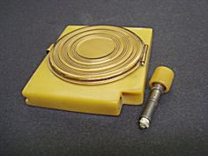 Uncommon Powder Compact and Lighter Bakelite. Click the image for more information.