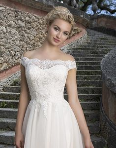 Style 3889: Lace, Tulle Ball gown accented with a Portrait neckline | Sincerity Bridal