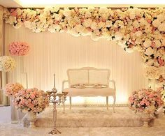Stunning Stage decor in all white and pink | Light pink decor | Vintage candle holder | Flower installation | White and pink roses | White drapes | Glass vases | Courtesy: Pinterest | Every Indian bride's Fav. Wedding E-magazine to read.Here for any marriage advice you need | www.wittyvows.com shares things no one tells brides, covers real weddings, ideas, inspirations, design trends and the right vendors, candid photographers etc.