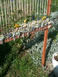 I've been looking for an idea on how to do this and here it is! Weaving in the garden.
