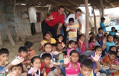 Jim Harbaugh NFL coach teaches faith, football to Peruvian kids :: Catholic News Agency
