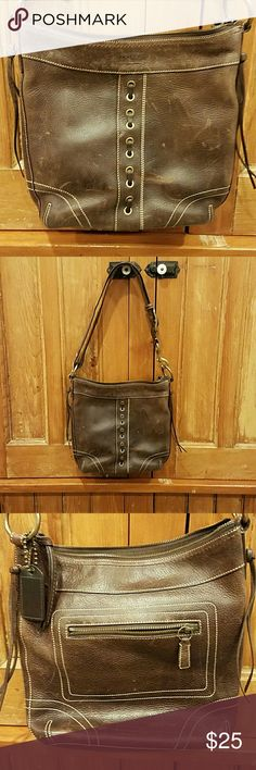 Coach brown distressed crossbody/shoulder bag Distressed brown leather.   Handle is adjustable to either wear on your shoulder or extend for crossbody.   Exterior zipper pocket. Zipper top closure.  2 interior slip in pockets. And one interior zipper pocket.  Excellent condition. Clean inside.   Distressed outside...no tears or holes Coach Bags Crossbody Bags