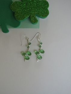 """HSP105 Drops For Luck - Sterling silver earrings, wrapped with Swarovski crystals and green glass elements.  11/2"""" length Sterling silver earwires."""