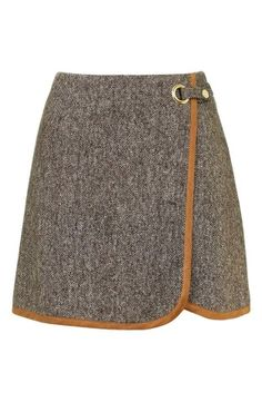 Channel your inner 90s girl with this tweed skirt from Topshop.