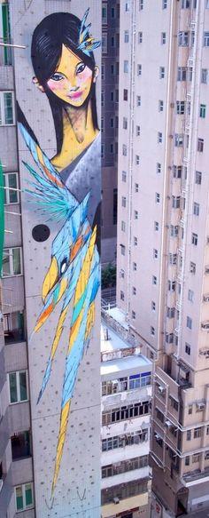 by TwoOne + Shida - 13 storey abseiling mural in Hong Kong