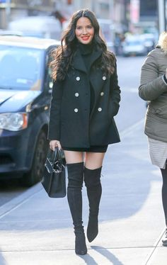 Olivia Munn in a Balenciaga black coat, A.L.C mini dress and over the knee suede boots