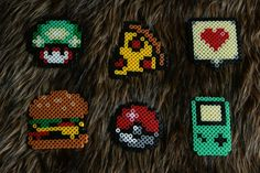 perlerbeads in different themes. You also can make it into a necklace by putting a ring into your art and hang it on a necklace.