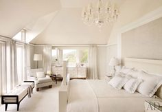 Traditional Master Bedroom with Clear Glass Chandelier, High ceiling, Chair rail, Carpet, French doors, Window seat