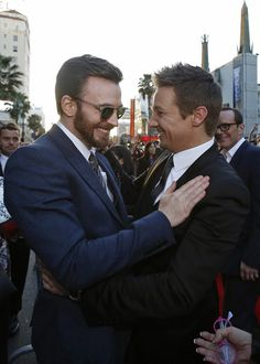 Chris Evans greets Jeremy Renner in Captain America: The Winter Soldier Premier