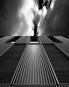 Artist: Stephen Murray ~ Title: Not Found ~ Medium: Photography ~ Size: Not Found ~ I chose this piece because the photographer captures the element of line using the linear architecture of the building.