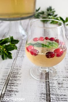 Best Champagne Punch with Gingerale, Orange Liqueur, Cranberies and Basil