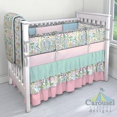 Custom baby bedding in Love Birds, Love Bird Damask, Aqua Minky, Solid Pink, Solid Mist, Solid Silver Gray, Solid Seafoam Aqua, Solid Bubblegum Pink. Created using the Nursery Designer® by Carousel Designs where you mix and match from hundreds of fabrics to create your own unique crib bedding. #carouseldesigns