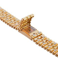 A Gold and Diamond Retro Watch/Bracelet by Uti. #Jewellery #Jewelry #Watch #Bracelet #RoseGold #Diamonds. Find out more: http://morelledavidson.com/product/gold-diamond-retro-watchbracelet-uti/