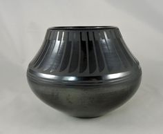 Traditionally hand built by the hands of Maria, stone burnished to a high shine, then decorated with the Feather motif by Popovi Da. The pit firing creates the black color, then then heat and timing cause the gunmetal finish, perfected by Popovi.