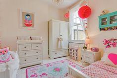 beautiful kids room.. Russian Doll painting, pretty rug, cute pillows.