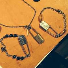 Pin ups.  #rustbeltamericana #rust #belt #americana #vintage #junkyard #jewelry #diaper #pin #rosary #beads #wood #bamboo #quartz #upcycle #necklace #bracelet