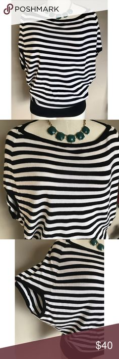 Michael Kors Striped Knit Blouse PreOwned. Good Condition. Striped Lightweight Knit Blouse. Flowy Blouse with Elastic at the bottom for a tight fit. Shoulder to bottom of shirt 25in. Across the chest 20in. Can fit all the way up to size 8. MICHAEL Michael Kors Tops Blouses
