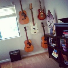 Hang Hubby's prized Guitars on the wall in our own house. Hubby's dream Guitar wall: CHECK.