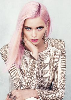 I think if you can pull off pale pink hair you should go for it. As this picture proves it can be done. Great makeup, too.