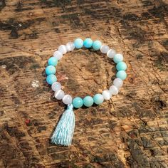 Unique handmade mint bead bracelet ♡ made of menthol jade, white cat's eyes and menthol cotton tassel.