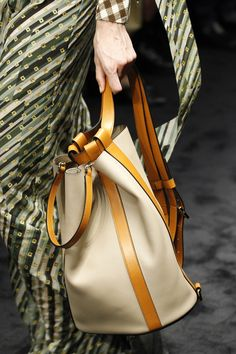 Loewe Fall 2017 Ready-to-Wear collection. I have a weak spot for bucket bags and backpacks, so what an easy choice this would be. The leather closure strap details are classic. Fashion Week, Fashion Bags, Rare Clothing, Loewe Bag, Leather Laptop Case, Leather Backpack, Business Chic, Stylish Backpacks, Popular Bags