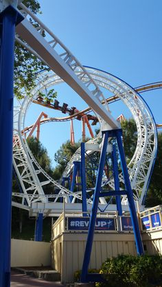 The New Revolution at Six Flags Magic Mountain in Valencia, California. Riders careen through steep banking turns and spirals in and out of the treetops. Revolution has a full 360 degree loop. In 2016, VR Goggles were added to intensify the ride.