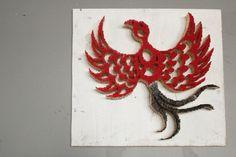 A Phoenix; medium: matches (some burnt). An elegant and stunning visual pun by Pei San Ng