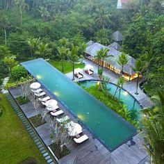 An infinity edge swimming pool located at the Alila Ubud, luxury boutique resort hotel in Ubud, Bali