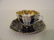 VINTAGE COBALT BLUE GOLD AND WHITE FOOTED DEMITASSE CUP AND SAUCER MADE GERMANY