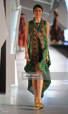 A model showcases designs by Dana Duryatna on the runway in the Mitology show during Indonesia Fashion Week 2015 at Jakarta Convention Center on February 26, 2015 in Jakarta, Indonesia.